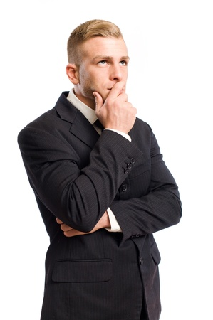 Portrait of a handsome young businessman, thinking. photo