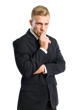 Portrait of a confident young businessman in thinking gesture. photo