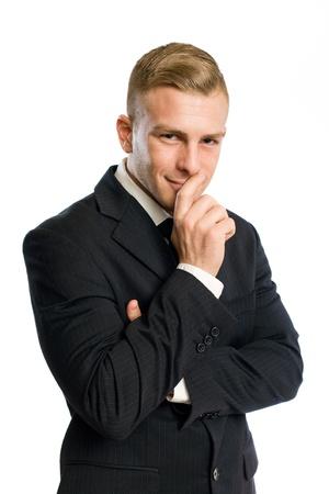 Portrait of a confident young businessman with mischievous smile. photo