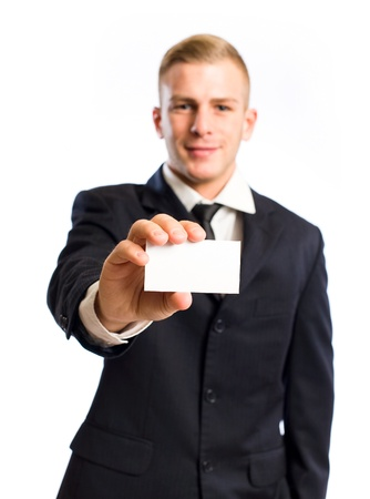 Half length portrait of a young businessman doing his introduction, focus on the card and hand. photo