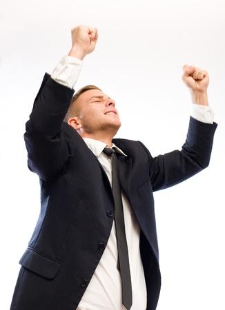 puños cerrados: Retrato de un hombre de negocios exuberante joven aislado sobre fondo blanco.