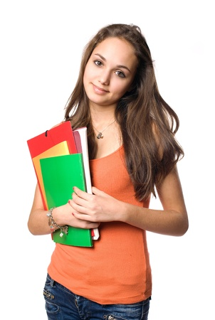 Sweet friendly young student girl holding colorful exercise books. photo