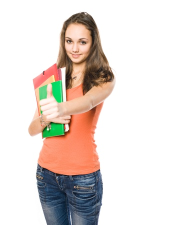Beautiful young brunette student girl showing thumbs up. photo