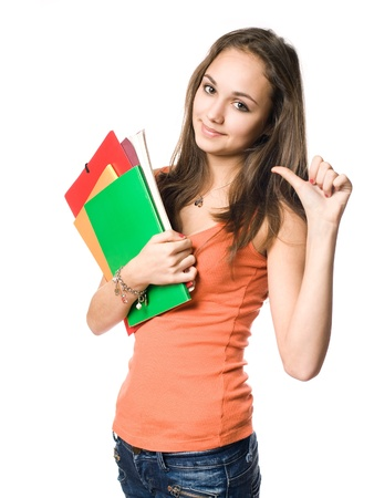 self confident: Beautiful young brunette student pointing towards herslef with thumb. Stock Photo