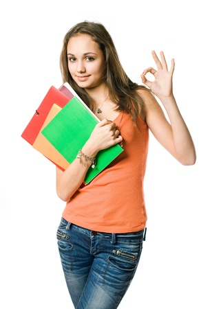 Doing fine here, half length portrait of beautiful young student girl showing ok sign. photo