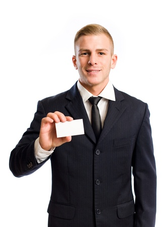 holding business card: Half length portrait of a handsome young busnessman.