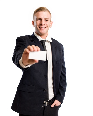relaxed business man: Half length portrait of an elegant young businessman doing introductions. Stock Photo