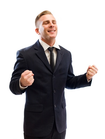 exuberance: Portrait of a handsome young businessman doing victorious gestures.