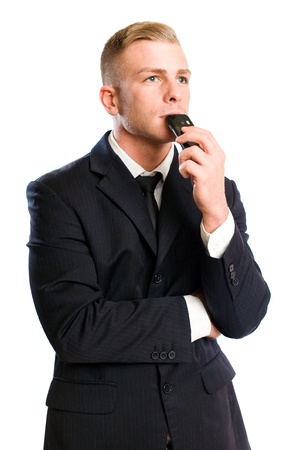 Portrait of a young businesman in thoughtful posture with his mobile phone. Stock Photo - 12204075