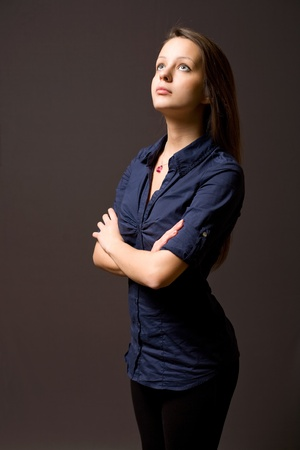 Strong character portait of beautiful young brunette woman. photo