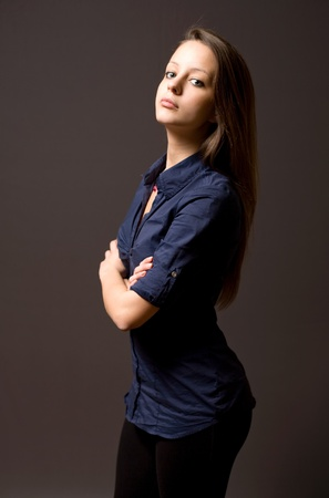 Half length portrait of an attractive young brunette woman. photo