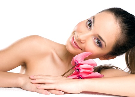 Portrait of a happy relaxed tanned brunette spa beauty. Stock Photo - 12363839