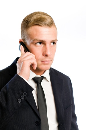 Portrait of a an elegant confident young businessman using his cellphone. Stock Photo - 12622161