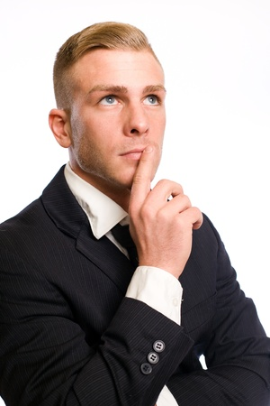 Portrait of a confident young businessman with thoughtful gesture  Stock Photo - 12622134