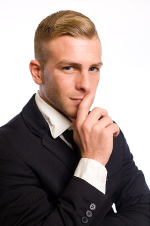 Portrait of an elegant young businessman in pondering gesture Stock Photo - 12622165