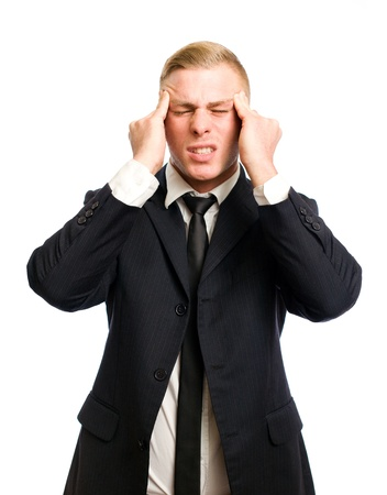 Elegant young businessman with gesture and posture suggesting pain, headache  photo