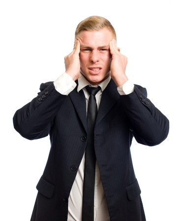 Extremely frustrated looking elegant young busniessman on white background  photo