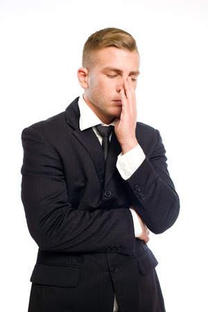Portrait of a very tired looking elegant young businessman Stock Photo - 12622140
