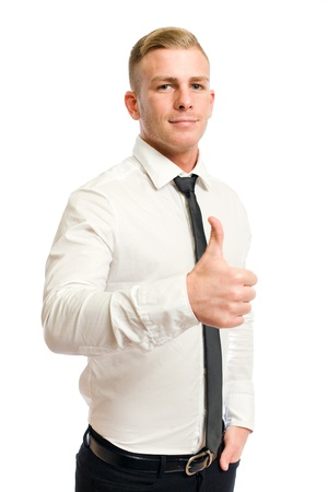 Confident looking young businessman showing big thumbs up  photo