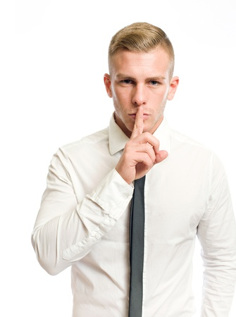 hand on mouth: Elegant young businessman showing silence gesture, hand over mouth