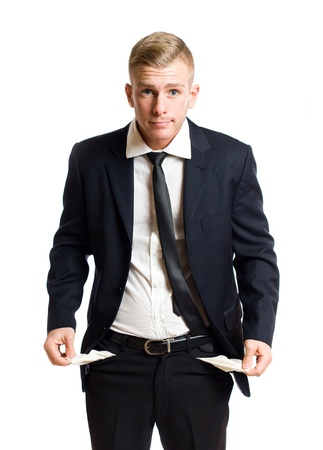fear of failure: Handsome young businessman displaying empty pockets