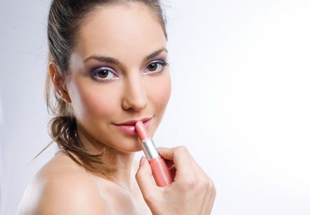Portrait of a pretty young brunette woman with lipstick  photo
