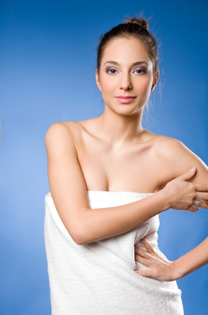 woman bathing: Portrait of a gorgeous relaxed spa girl wrapped in towels
