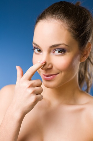 Beautiful young brunette woman after spa applying moisturizer Stock Photo - 12621964