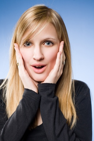 happily: Wow, what an offer, portrait of a happily surprised beautiful young blond.