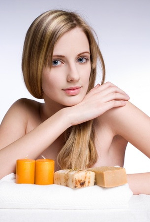 Portrait of a blond spa beauty displaying hand made organic camomile milk honey soaps Stock Photo - 12622178