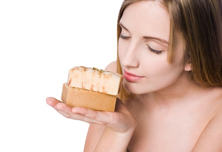 honey blonde: Portrait of spa beauty with hand crafted organic camomile honey milk soap  Stock Photo