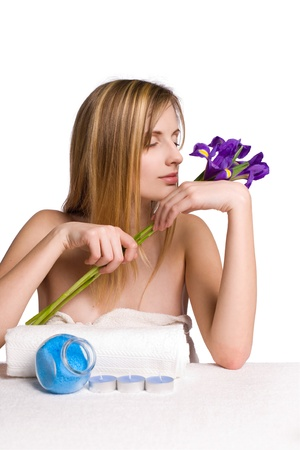portrait of a blond spa girl with iris flowers isolated on white  photo