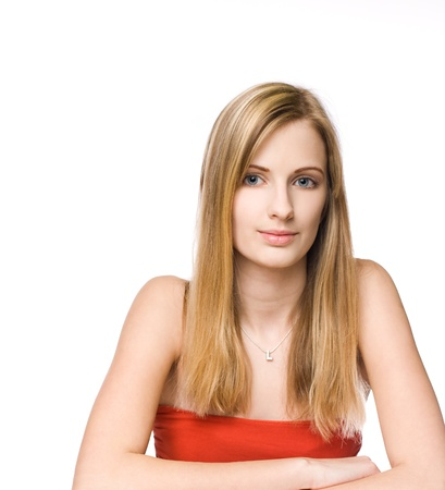 Portrait of a confident blond beauty isolated on white background