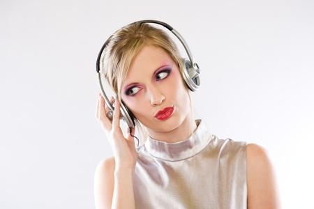 gir: Beautiful blond electro pop gir enjoying music in headphones.