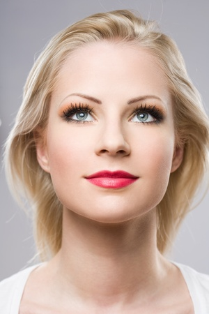 Clean portrait of a beautiful relaxed blond woman in elegant makeup. photo
