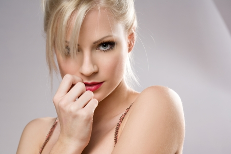 seduction: Portrait of a sensual seductive young blond woman.