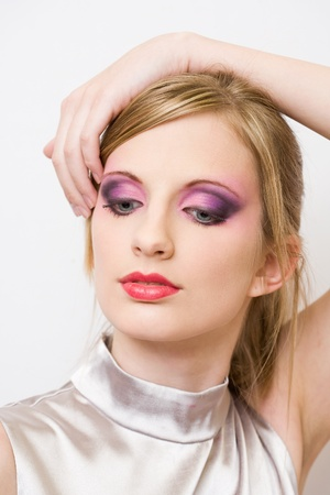 eye shade: Portrait of retro styled young blond in colorful makeup. Stock Photo