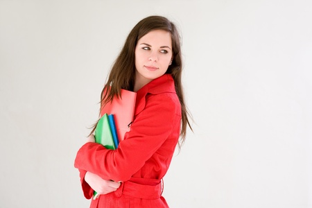 sideways glance: Colorful personality, portrait of a cute confident young student girl in red coat