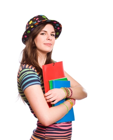 Half length portrait of a confident student girl in very colorful clothes, isolated on white background  photo