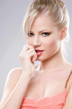Portrait of an attractive young blond woman in sensual pose. photo