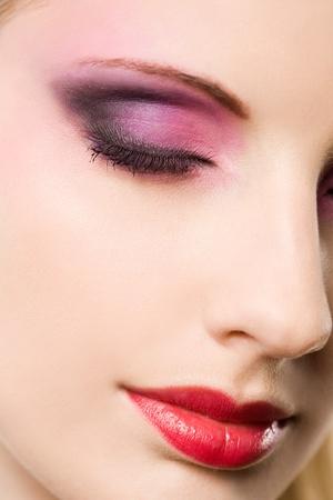 Closeup portrait of a blond beauty with elegant colorful makeup. photo