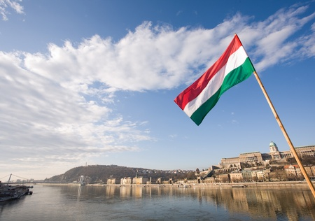 europe eastern: The Hungarian flag over river Danube and facades of historic buildings in Buda. Stock Photo