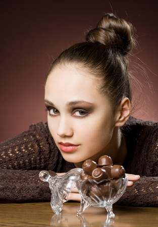 cravings: Chocolate cravings, beautiful young brunette with chocolate bonbons