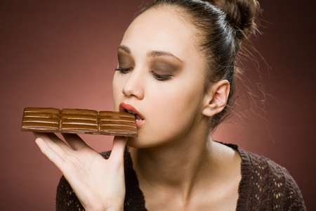 Even more chocolate, gorgeous young brunette girl with severe chocolate cravings Stock Photo - 13166552