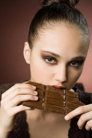 cravings: Even more chocolate, gorgeous young brunette girl with severe chocolate cravings