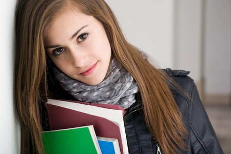 Closeup portrait of a shy young brunette student girl. photo