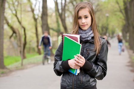 Portrait of a cool fashionable young student girl outdoors. Stock Photo - 13454385