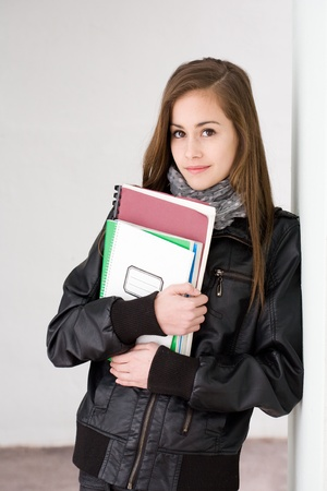 Portrait of a beautiful fashionable young brunette student girl. photo