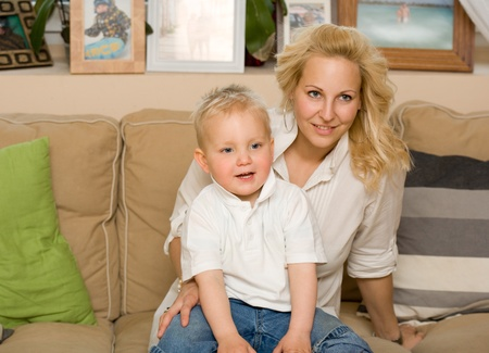 Indoors portrait of a young attractive mother with her cute son. photo