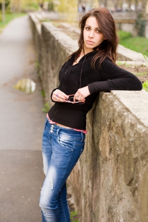 Portrait of a slender cute young brunette posing outdoors. Stock Photo - 13610150